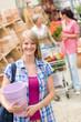 Woman hold flower pot garden centre store