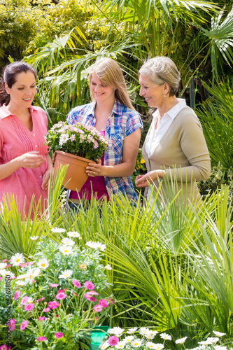 Three women shopping flowers at green house