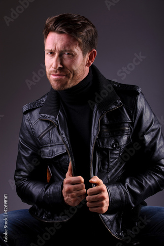 handsome man in leather jacket seated