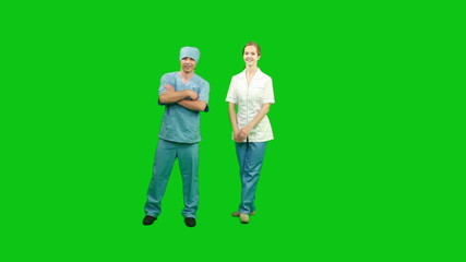 Doctors standing and smiling. Green screen.