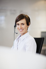 Portrait of smiling businesswoman wearing headset