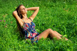 Beautiful young woman relaxing in grass