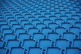 blue folding plastic seats at an outdoor event