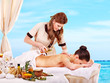 Woman getting spa treatment outdoor.