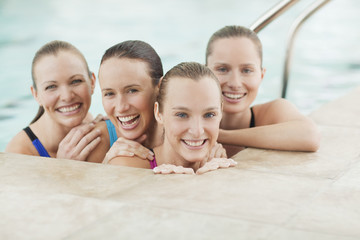 Portrait of smiling young women in swimming pool