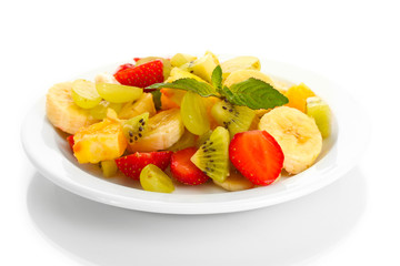 Fresh fruits salad on plate isolated on white