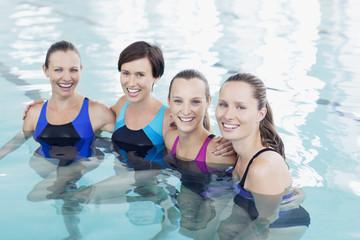 Portrait of smiling women in swimming pool