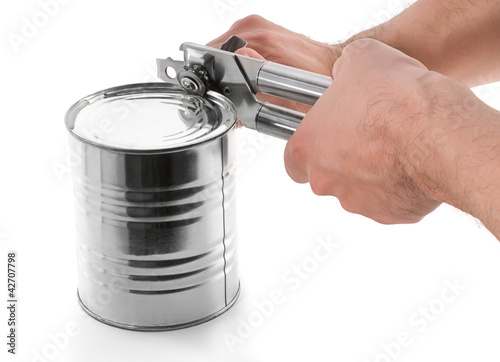 Opening tin with can opener isolated on white background