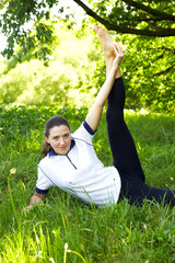 Beautiful sport woman doing stretching fitness exercise outdoor
