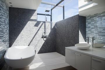 Sun shining through window in modern bathroom