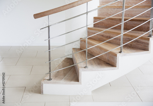 Wooden staircase and railing in modern house
