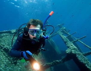Diver exploring a wreck, island Elba, Italy