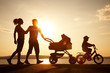 happy family walking on sunset