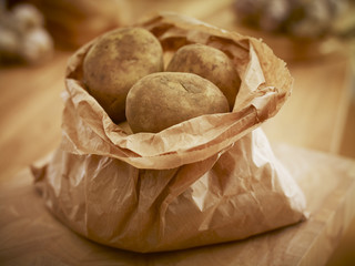 Organic potatoes in paper bag