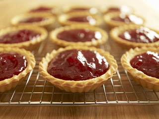 Close up of jam tarts cooling on wire rack