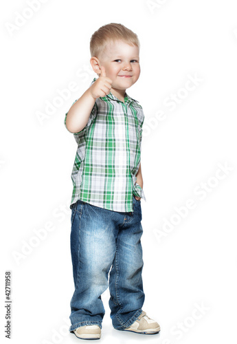 Portrait of beautiful little boy giving you thumbs up over white