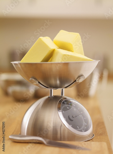 Cubes of butter on scale