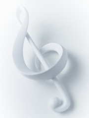 Close up of treble clef musical note on white background