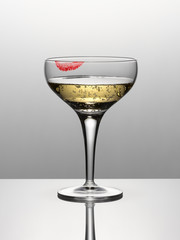 Close up of champagne in glass with lipstick stain