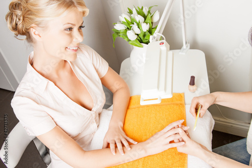 woman having a manicure at the salon