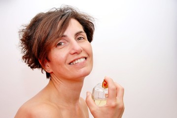 young woman applying parfume