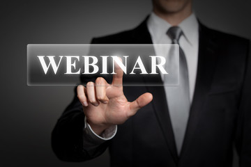 businessman pressing touchscreen button - webinar