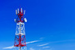 Telecommunications tower, painted white and red in a day of clea