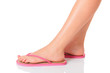 Female feet with flip-flops, isolated on white background