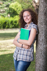 Young Beautiful Female Student at Park