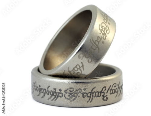 Two rings of porous silvery metal with arabic ligature isolated