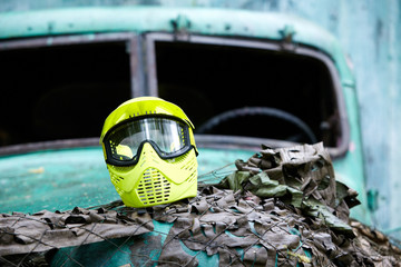 Yellow protective mask for paintball players lies