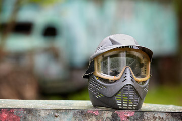 Gray stained protective helmet for paintball player