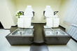 Two armchairs and bathtubs in pedicure cabinet in beauty salon
