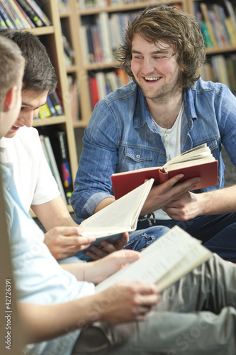 Happy Students Reading Books In Library