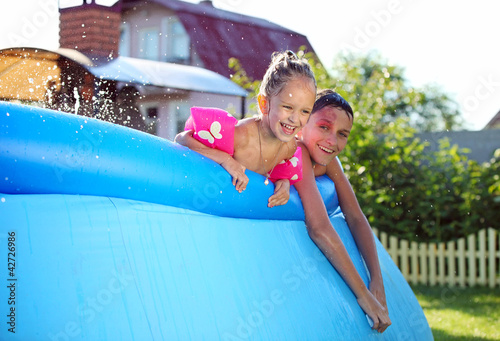 Kids swimming in a inflatable swimming pool