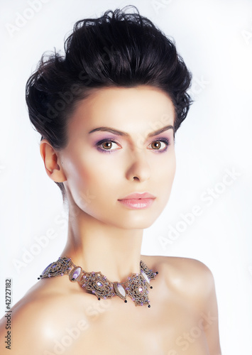 Beauty model with natural makeup, clean skin. White background