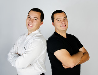 Two attractive smile young men twins