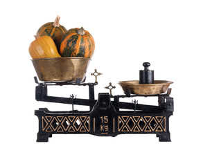 Old-fashioned balance scale with pumpkins
