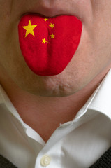 man tongue painted in china flag symbolizing to knowledge to spe