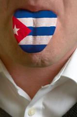 man tongue painted in cuba flag symbolizing to knowledge to spea