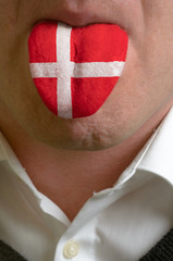man tongue painted in denmark flag symbolizing to knowledge to s