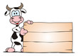 Cow standing beside Board