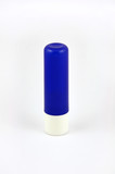 Blue tube of lip balm isolated on white background