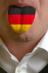 man tongue painted in germany flag symbolizing to knowledge to s