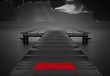 Moody empty jetty with red mat against stormy clouds