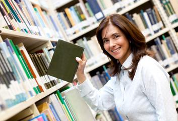 Librarian placing a book