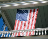 Big American Flag on an elegant balcony