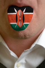 man tongue painted in kenya flag symbolizing to knowledge to spe