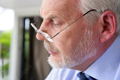 Closeup of a senior man in glasses