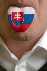 man tongue painted in slovakia flag symbolizing to knowledge to